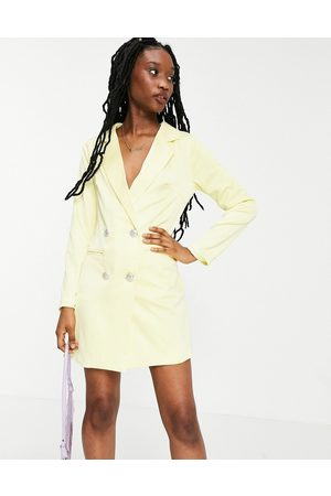 Collective The Label Tailored blazer mini dress with crystal buttons in lemon-Yellow