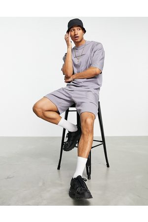 ASOS ASOS Unrvlld Spply co-ord relaxed shorts with cut & sew nylon panels in black