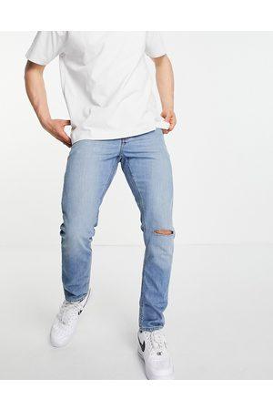 ASOS DESIGN Slim jeans in vintage mid wash with knee rip-Blue