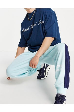 ASOS Co-ord oversized joggers with colourblock cut and sew detailing and logo print in blue