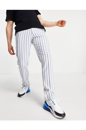 ASOS DESIGN Slim soft tailored suit trousers with blue stripe and jogger waistband
