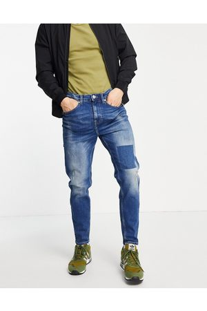 New Look Tapered jeans in blue wash