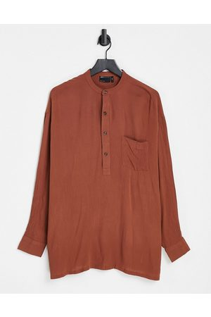 ASOS Oversized crinkle viscose overhead shirt with half placket in brown