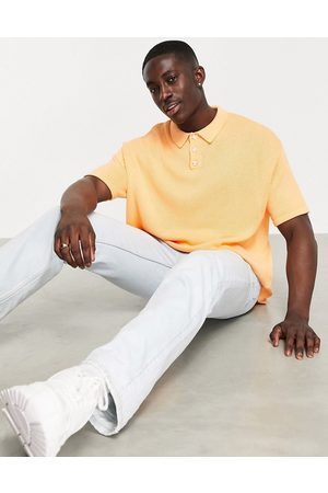 ASOS Knitted midweight polo t-shirt in peach-Pink