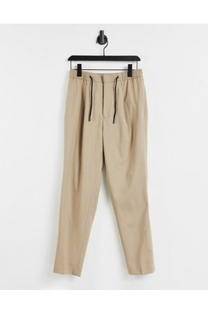 ASOS DESIGN Tapered smart jogger in stone-Neutral