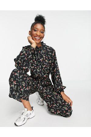 ASOS DESIGN Shirred waist ditsy floral frill neck jumpsuit-Multi