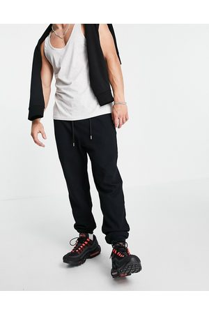 ASOS DESIGN Tapered waffle joggers in black