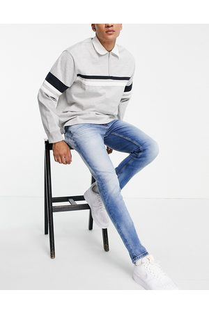 Tommy Jeans Austin slim fit jeans in light blue