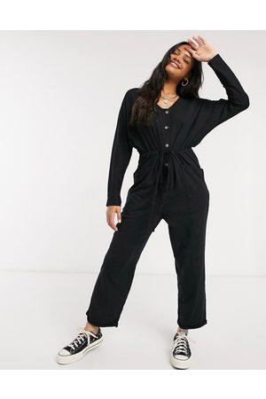 ASOS DESIGN Lounge jersey button front long sleeve tie waist jumpsuit in black