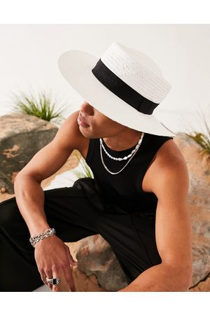 ASOS DESIGN Wide brim pork pie straw hat in white with black band and size adjuster