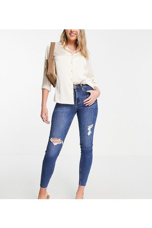River Island Ripped raw hem high rise skinny jeans in mid auth blue