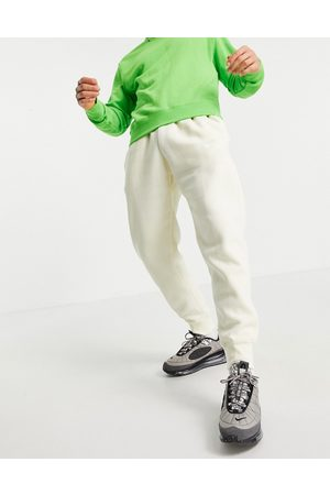 Nike Club cuffed joggers in cream-White