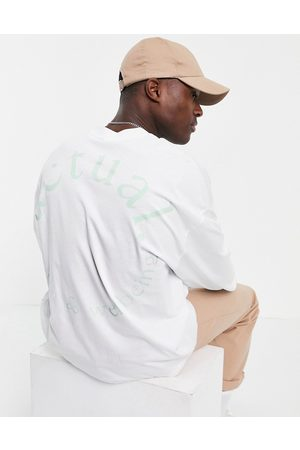 ASOS Actual Athleisure oversized long sleeve t-shirt with back circle logo back print in white