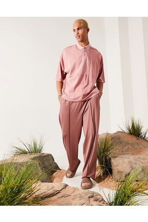 ASOS DESIGN Oversized polo in washed pink with waffle