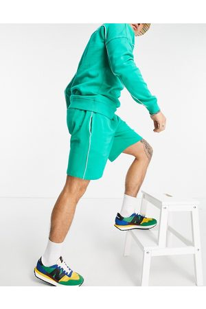 ASOS Co-ord oversized jersey shorts with piping in green