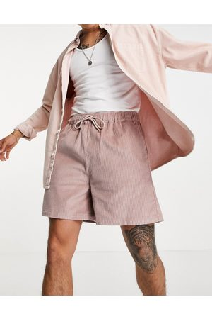 ASOS DESIGN Wide fit shorts in pink cord