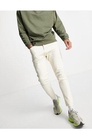 Topman Stretch tapered jeans in ecru-White