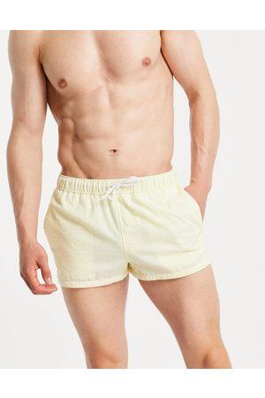 ASOS DESIGN Swim shorts in yellow seersucker super short length