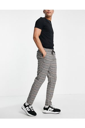 ASOS DESIGN Slim trousers with elasticated waist in brown check-Grey