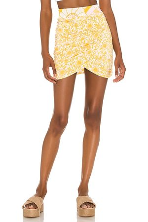 Free People She's Something Else Mini Skirt in - Yellow. Size L (also in XS, S, M, XL).