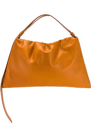 SIMON MILLER Large Puffin Shoulder Bag in - Tan. Size all.