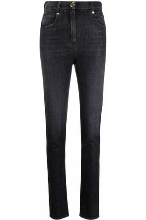 Balmain High-waisted button-detail denim jeans