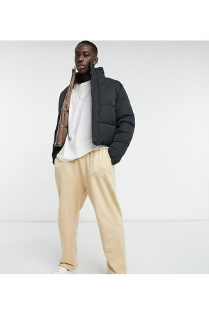 ASOS DESIGN Organic super oversized joggers in beige with toggle hem-Neutral