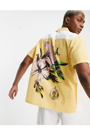 ASOS DESIGN Relaxed revere shirt with patchwork back placement floral-Yellow