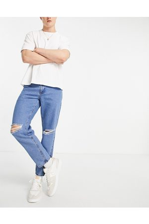 ASOS Classic rigid jeans in flat mid blue with knee rips