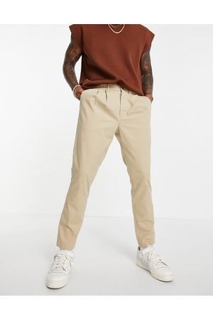 ASOS Cigarette chinos with pleats in beige-Neutral