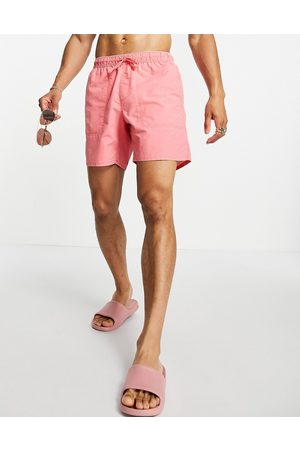 ASOS Swim shorts with contrast stitching and acid wash mid length-Pink