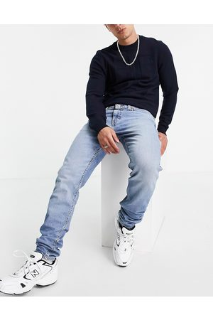 Levis Levi's 512 slim tapered fit lo-ball jeans in mid wash blue