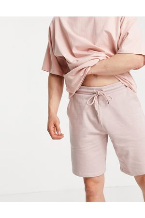 ASOS Co-ord oversized jersey shorts in pink