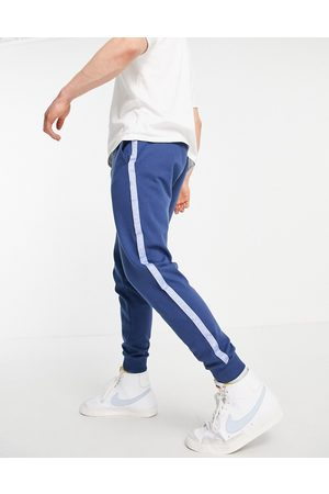 ASOS Homem Joggers - Co-ord oversized joggers with blocking and numeral tape-Navy