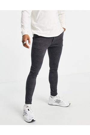 ASOS Homem Joggers - Extreme super skinny smart jogger in blue check
