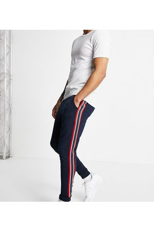 ASOS DESIGN Homem Joggers - Skinny joggers with side stripe in navy
