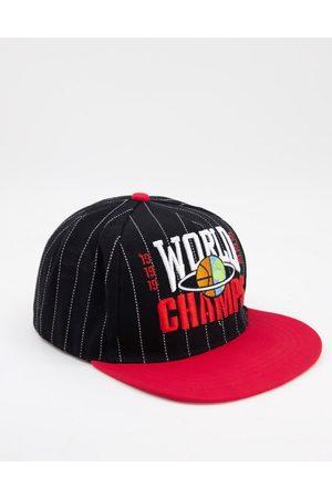 ASOS Snapback cap in black with vintage stripe detail