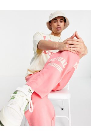 ASOS Co-ord relaxed jogger with athleisure logo print in pink