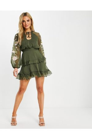ASOS Blouson sleeve tiered mini dress with cross stitch embroidery detail and tie in khaki-Green