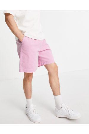 ASOS DESIGN Boxy chino shorts in bright pink wash