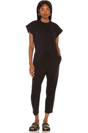 PISTOLA Decklin Shoulder Pad Sleeveless Jumpsuit in - Black. Size L (also in XXS, XS, S, M).