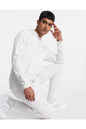 ASOS DESIGN Tracksuit with hoodie & cargo skinny jogger in white marl