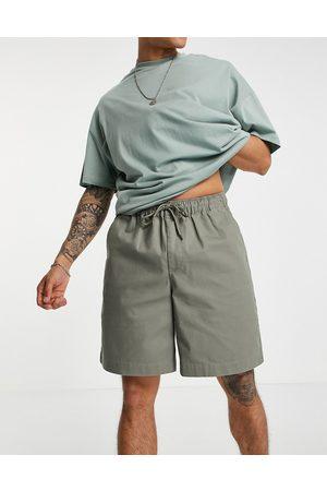 ASOS Boxy chino shorts in light khaki-Green