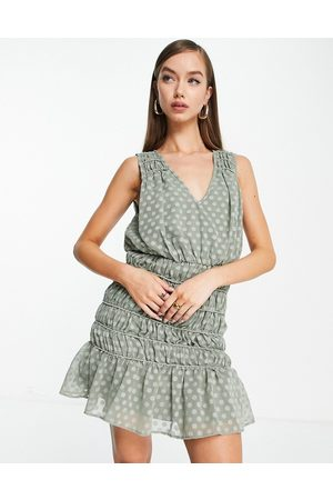 ASOS Soft sleeveless mini dress with ruched skirt in dobby in khaki-Green