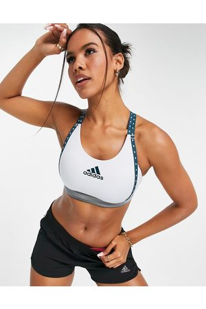 adidas performance Adidas Training mid support bra with taped logo in light blue