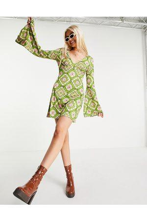 ASOS DESIGN Slinky flare sleeve mini dress in green crochet print-Multi