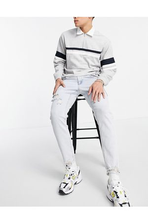 ASOS DESIGN Stretch slim jeans in 90's bleach wash with rips-Blue