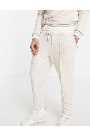 ASOS Homem Joggers - Co-ord tapered joggers in smart textured check with fixed hem & pin tucks-Neutral