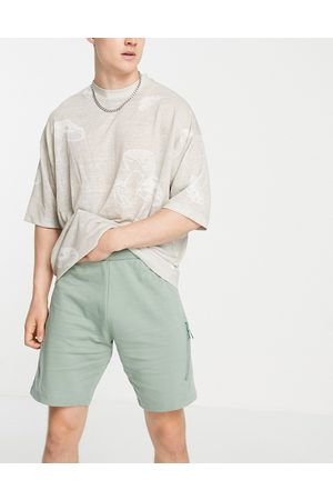 ASOS DESIGN Co-ord jersey shorts with utility seams in green