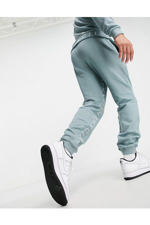 ASOS Co-ord tapered joggers with Roman numerals inside tape in blue grey